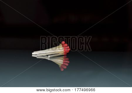 matches sticks reflection on glass with pink reddish color
