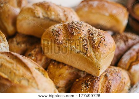 Fresh bread from cereals with seeds from a bakery. Healthy and nutritious food. The product contains carbohydrates. poster
