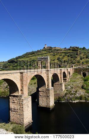Roman bridge over the Tajo river in Valencia de Alcantara Extremadura Spain (In the top view of the town of Valencia de Alcantara)