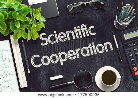 Scientific Cooperation Handwritten on Black Chalkboard. 3d Rendering. Toned Image.