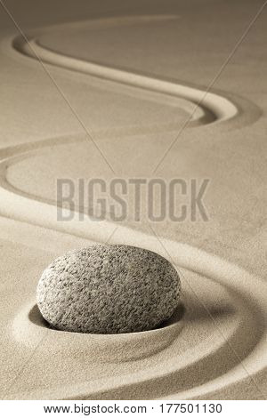 zen meditation stone and sand, a spiritual japanese rock garden. Abstract harmony and balance concept for purity concentration spa relaxation.