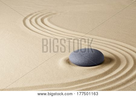 Zen meditation stone garden background. Stone on fine sand standing for balance, harmony concentration and relaxation.