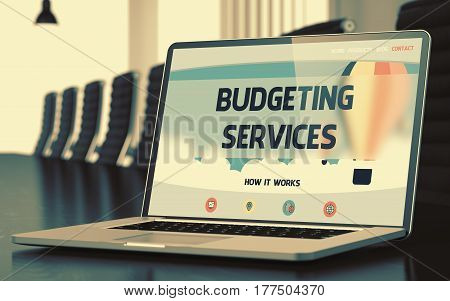 Budgeting Services - Landing Page with Inscription on Mobile Computer Display on Background of Comfortable Meeting Room in Modern Office. Closeup View. Toned Image with Selective Focus. 3D.