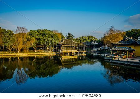 SHANGHAI, CHINA: Famous Zhouzhuang water town, ancient city district with channels and old buildings, charming popular tourist area.