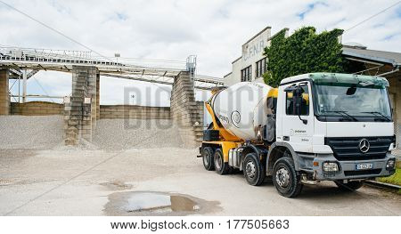 STRASBOURG FRANCE - JUN 19 2016: Mercedes-Benz Actros concrete truck from UNIBETON factory member of Italcementi Group in front of modern Beton Concrete Factory on a summer day