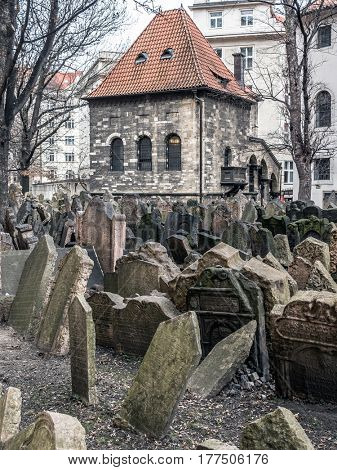 PRAGUE, CZECH REPUBLIC - MARCH 6 2017: Old Jewish cemetery with the Ceremonial Hall in the background, Prague, Czech Republic