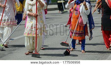 Many Sikhs  Women Barefoot While Scavenging The Road