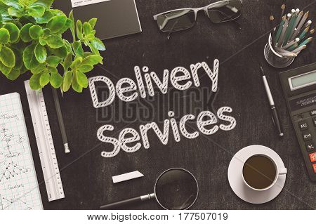 Delivery Services. Business Concept Handwritten on Black Chalkboard. Top View Composition with Chalkboard and Office Supplies. 3d Rendering. Toned Illustration.