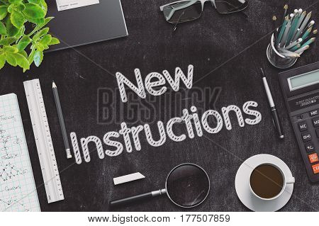 Top View of Office Desk with Stationery and Black Chalkboard with Business Concept - New Instructions. 3d Rendering. Toned Image.