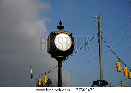 MANCELONA, MICHIGAN / UNITED STATES - NOVEMBER 27, 2016: The municipal clock provides the time in in downtown Mancelona.