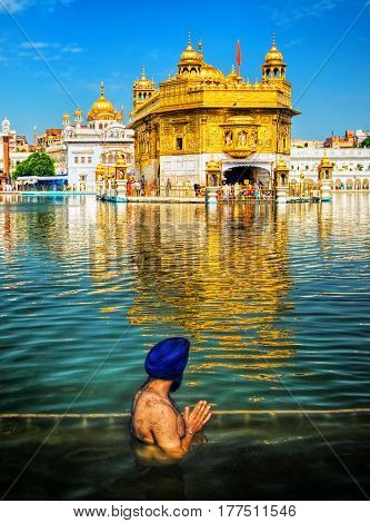 The Sikh prayer in the lake of Harmandir Sahib or Golden Temple Amritsar India