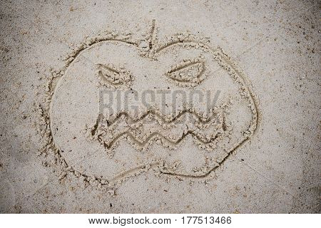 Halloween Pumpkin Drawn In The Sand