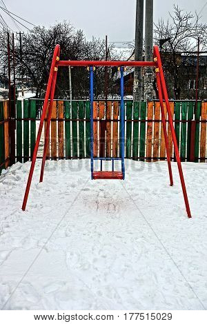 Iron swing at the playground in the winter