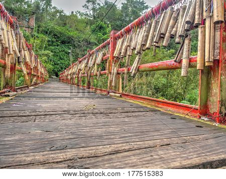Jingtong Taiwan - October 05 2016: Bridge of lovers with wishes written on bamboo sticks hanging down in Jingtong