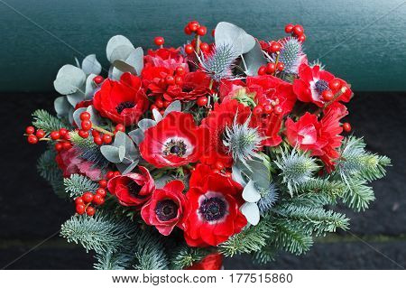 Red Christmas bouquet with anemone and daisy Gerber flowers