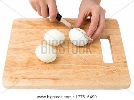 cook eggs on cutting board on a white background .