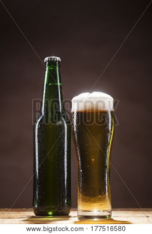 Beer Bottle And Mug On Brown Background