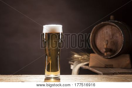 Beer Barrel With Beer Mug On Brown Background