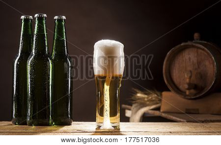 Beer Barrel With Three Bottles And Mug On Brown Background