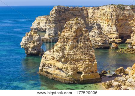Beautiful yellow cliffs at Marinha beach, Algarve Portugal