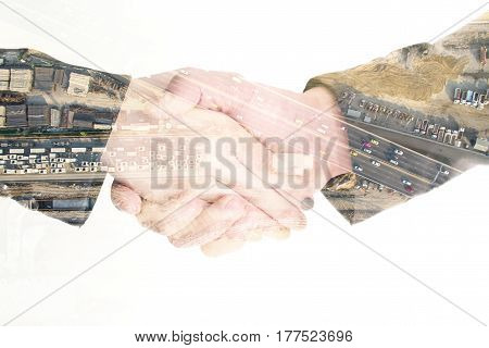 Isolated Double Exposure Business Handshake And Construction