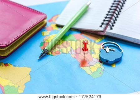 Preparation and booking travel concept with notebook on map background