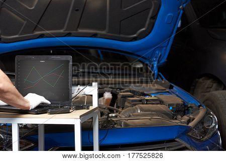 Mechanic Testing Car Engine