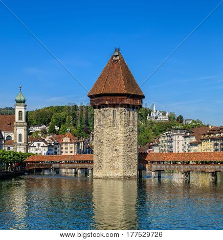 Lucerne, Switzerland - 7 May, 2016: the Reuss river, Water Tower and Chapel Bridge. Lucerne is a city in central Switzerland, it is the capital of the Swiss canton of Lucerne and the capital of the district of the same name.