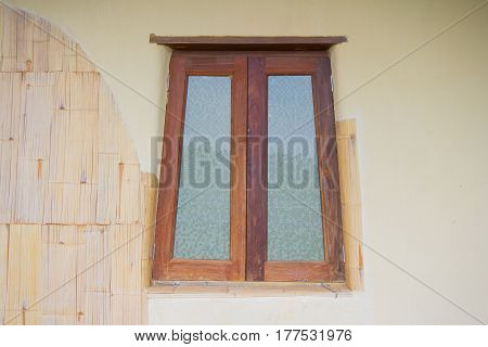 old wooden window with glass on earthen wall