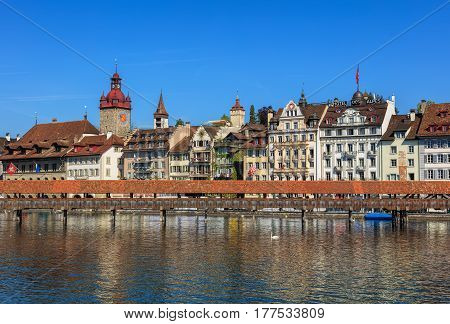 Lucerne, Switzerland - 7 May, 2016: the Chapel Bridge over the Reuss rivea, old town buildings in the background. Lucerne is a city in Switzerland, it is the capital of the Swiss canton of Lucerne and the capital of the district of the same name.
