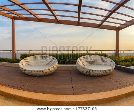 Relax corner on condominium rooftop garden with chairs.