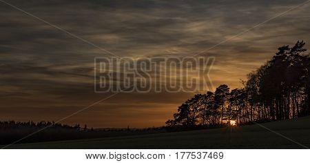 Sunset near Bezdez castle in spring evening in north Bohemia