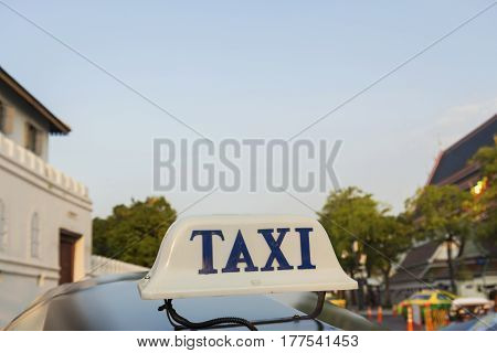 taxi cab of tuk tuk car in background at south of grand palace bangkok Thailand. tuk tuk is tradition taxi of thailand