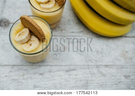 Top View Of Banana Pudding With Cookies On White Wooden Board For Breakfast, Healthy Vegetarian Dess