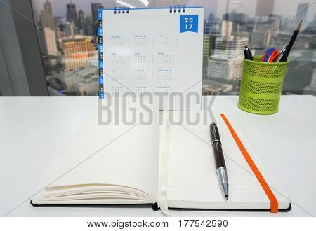 mock up notebook with 2017 calendar and office stationary