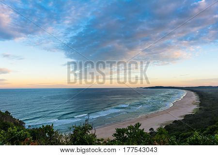 The beautiful sunset and the view on Tallows beach in Byron Bay, Australia