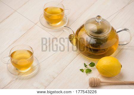 Cup Of Lemon Tea With Honey On White Wooden Background.