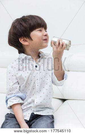 Asian Chinese Little Boy Playing Retro Tin Can Phone