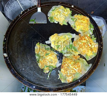 Omelets With Oysters And Greens