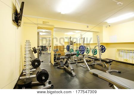 Fitness hall with weights and other sport equipment