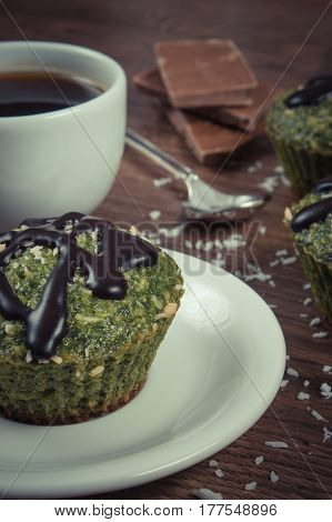 Vintage Photo, Fresh Muffin With Spinach, Desiccated Coconut, Chocolate Glaze And Cup Of Coffee, Del