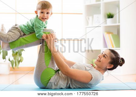 family mother and child son are engaged in meditation and yoga, exercising at home