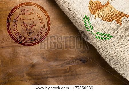 Stamp on a wooden background Made in Cyprus. Stamp and Cyprus flag.