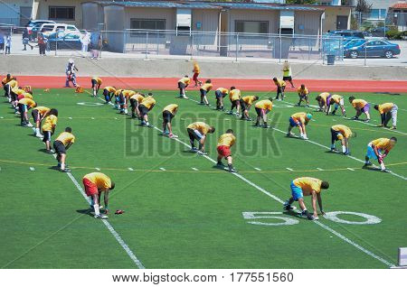 they workout for football camp in hot sun