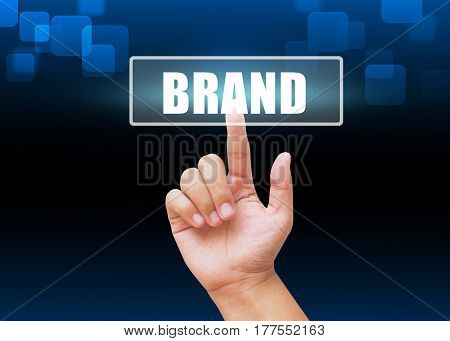 Hand pressing brand  buttons with technology background