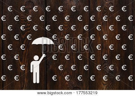Paper man with umbrella standing in rain of euro money concept abstract conceptual image