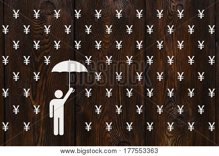 Paper man with umbrella standing in rain of yen money concept abstract conceptual image