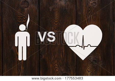 Man with cigarette and heart shape with echocardiogram. Health or quit smoking concept. Abstract conceptual image
