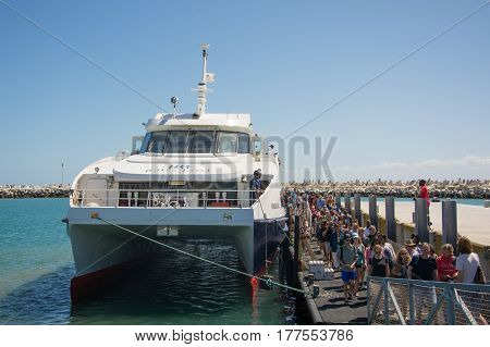 Cape Town South Africa - March 03 2017: Visitors to Robben Island arrive by Catamaran from the V&A Waterfront Cape Town