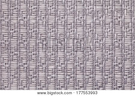 Light gray knitted woolen background with a pattern of soft fleecy cloth. Texture of silver textile closeup.